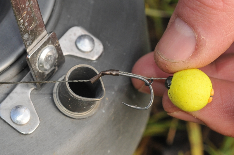 12 Carefully position and then pinch the shot so that it sits inside the bottom of the bait.