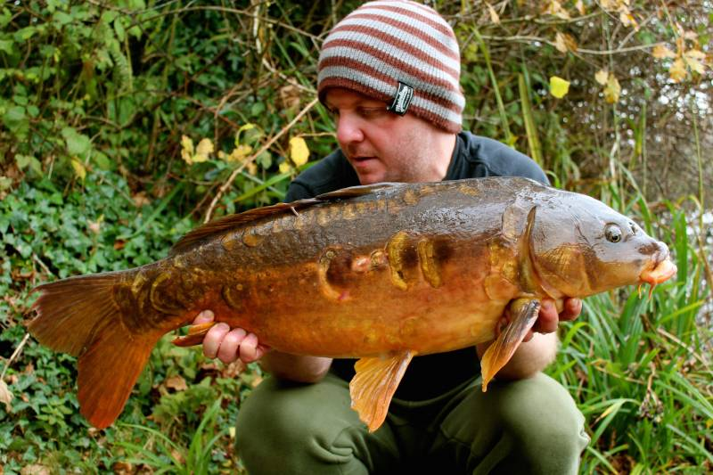 After a top up of bait it didn't take long to hook his scattered mirror
