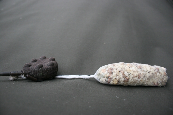 The rig plus PVA stocking will blend in with the little piles of bait.