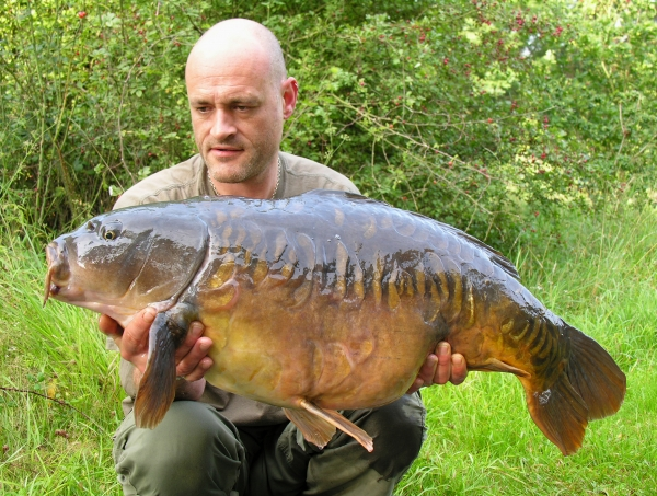 Out in the boat again to land this 29lb 2oz mirror!